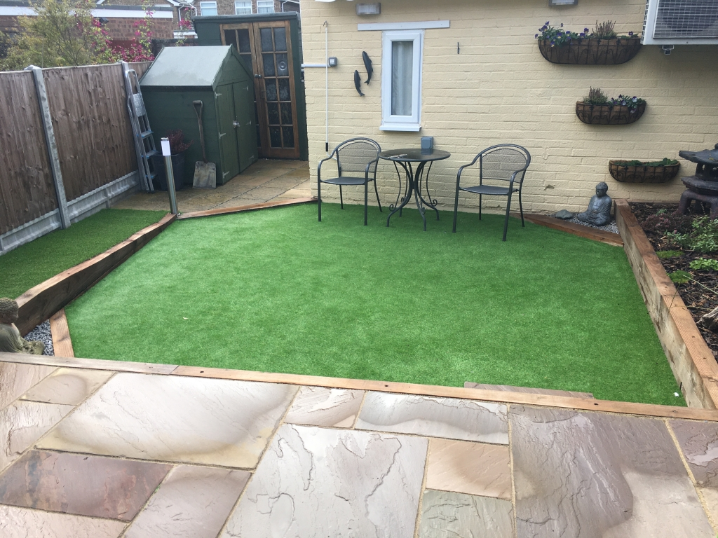 The finished garden with artificial grass, wheelchair ramp, new patio, wall hanging baskets & even a border for plants. At this point it is undeniable; Therapists do need therapy - and you can't treat yourself